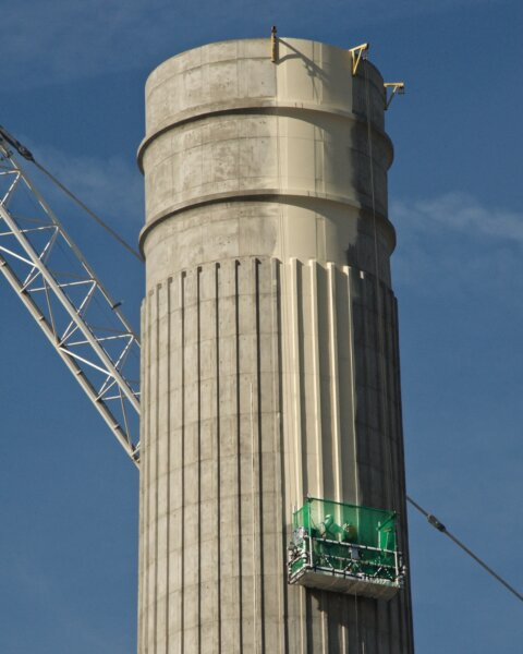 detail of a Battersea Power Station chimney being repainted