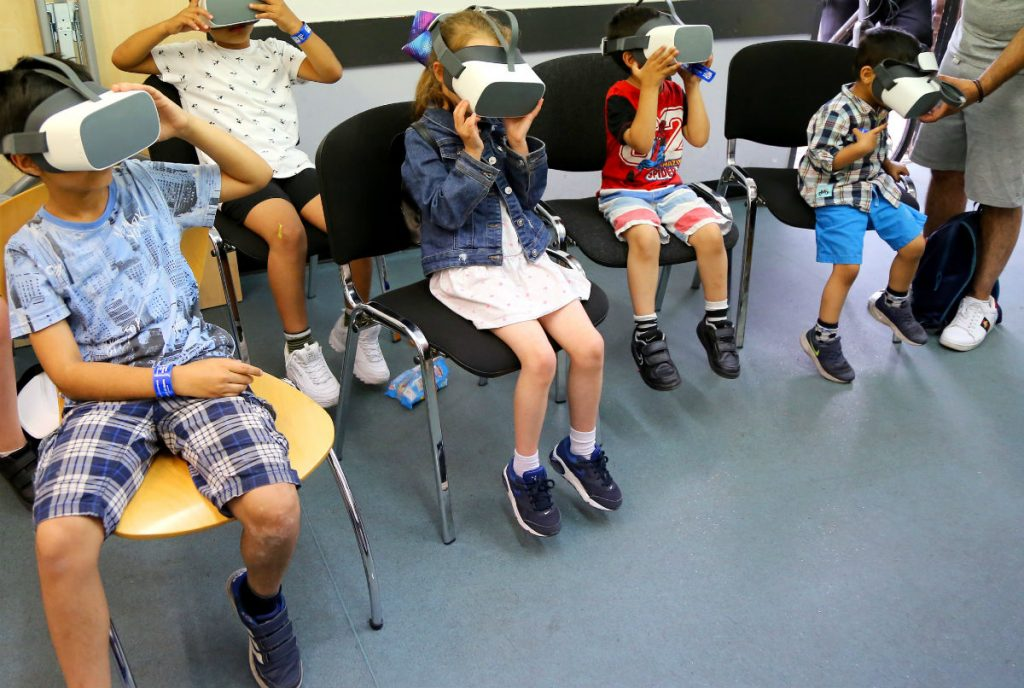 Children with LIVR virtual reality headsets