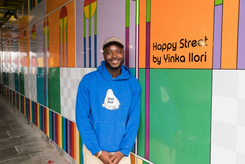 Designer Yinka Ilori checks out the finished underpass artwork