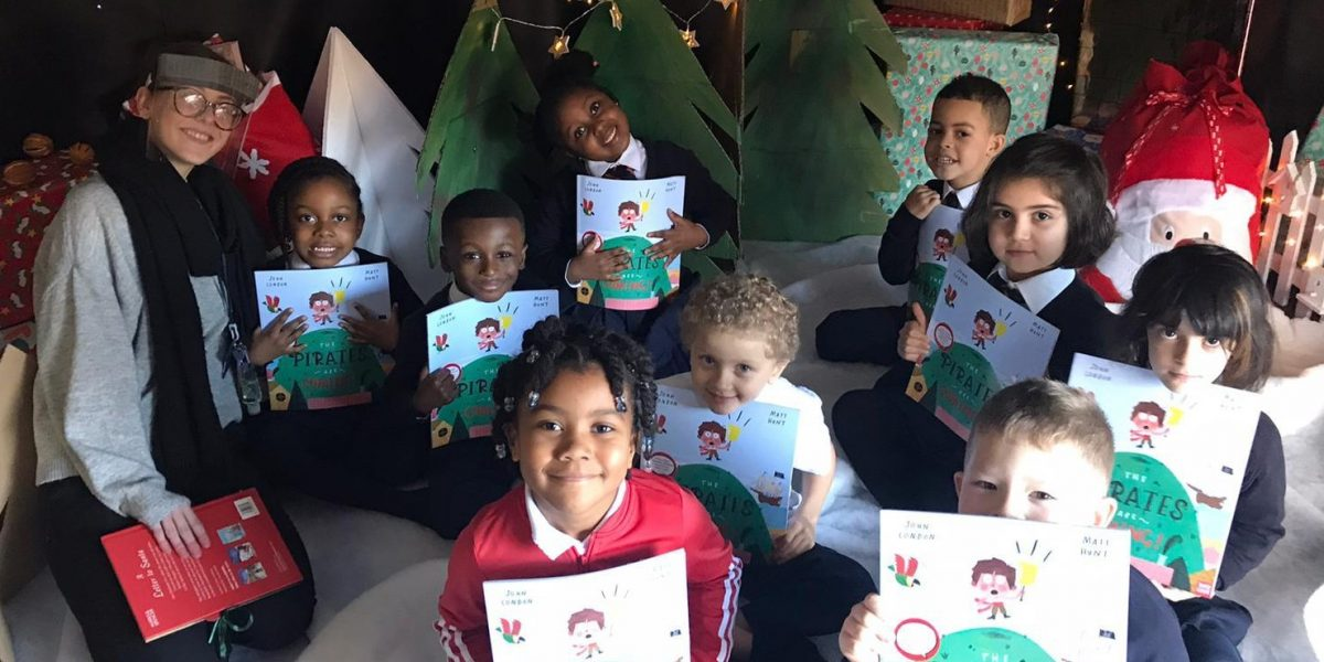School children with the Battersea Power Station donated books