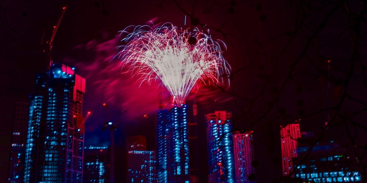 Red fireworks at One Thames City