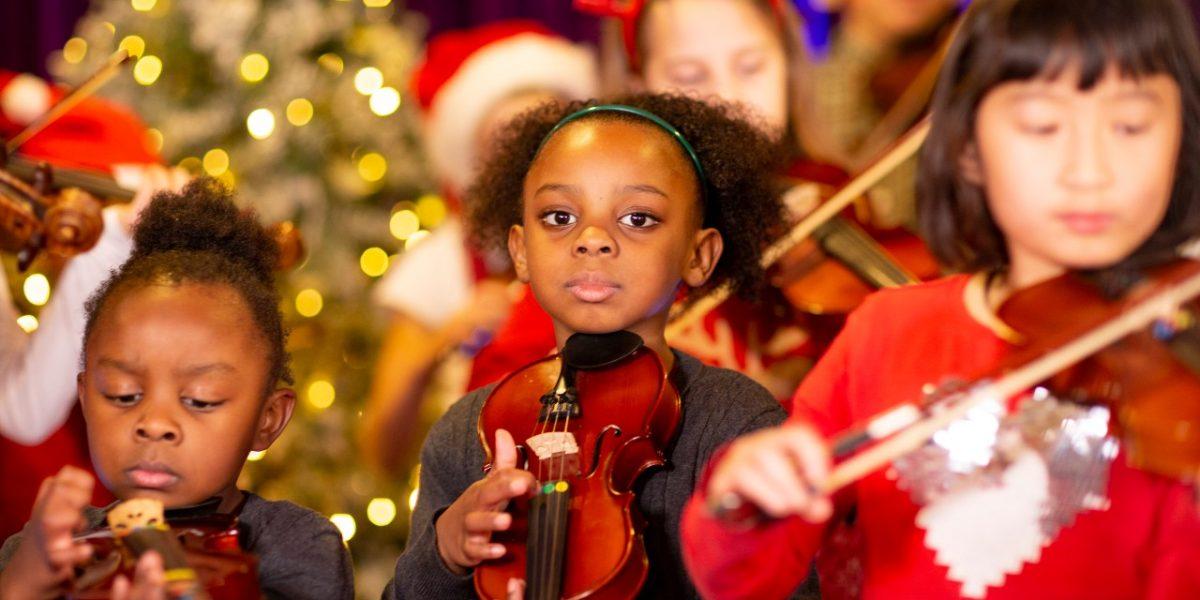 World Heart Beat Christmas Concert, children playing instruments