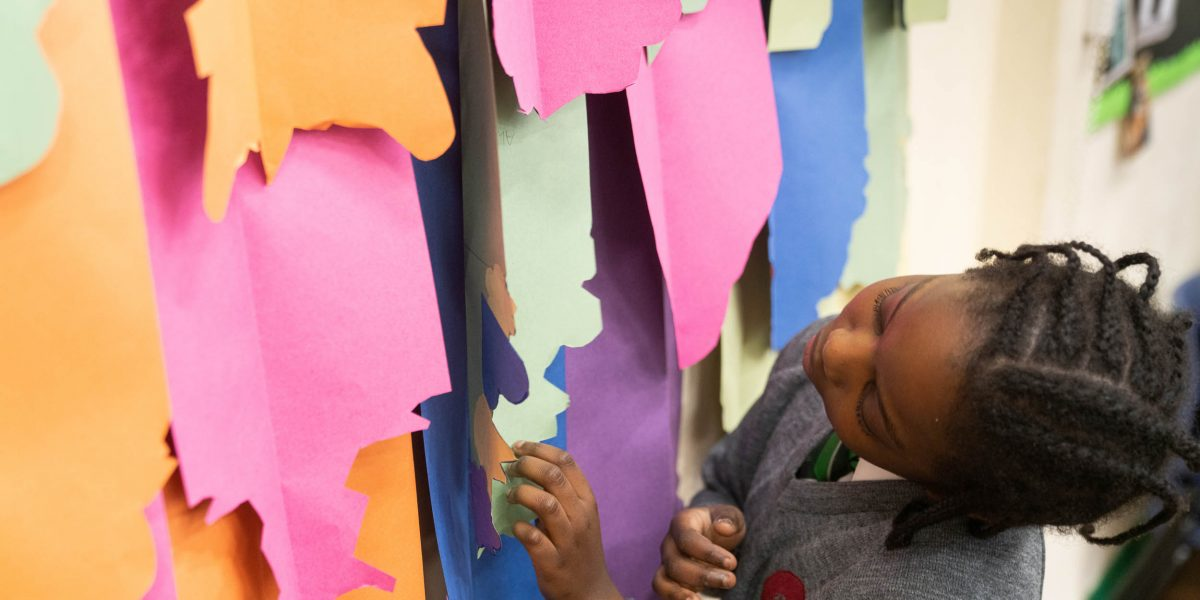 A pupil looks at daggerboard designs at Griffin Primary