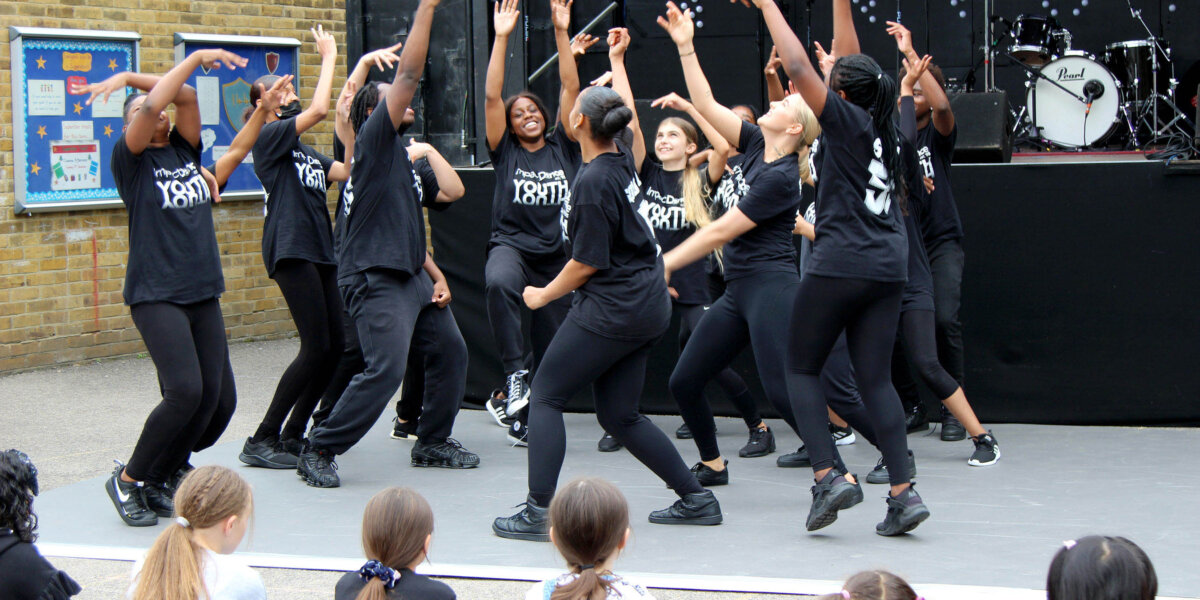 Impact Dance perform on the main stage at Happy Streets Festival
